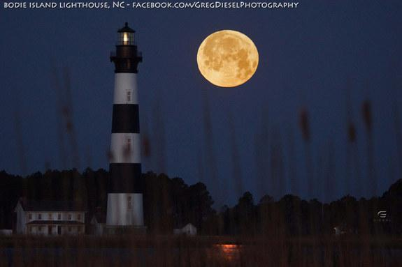 """Astrophotographer Greg Diesel Walck sent in a photo of the full moon setting by the Bodie Island Lighthouse, Outer Banks, NC, taken March 27, 2013. He writes: """"I have been trying to get a shot like this for almost a year. The weather and timin"""