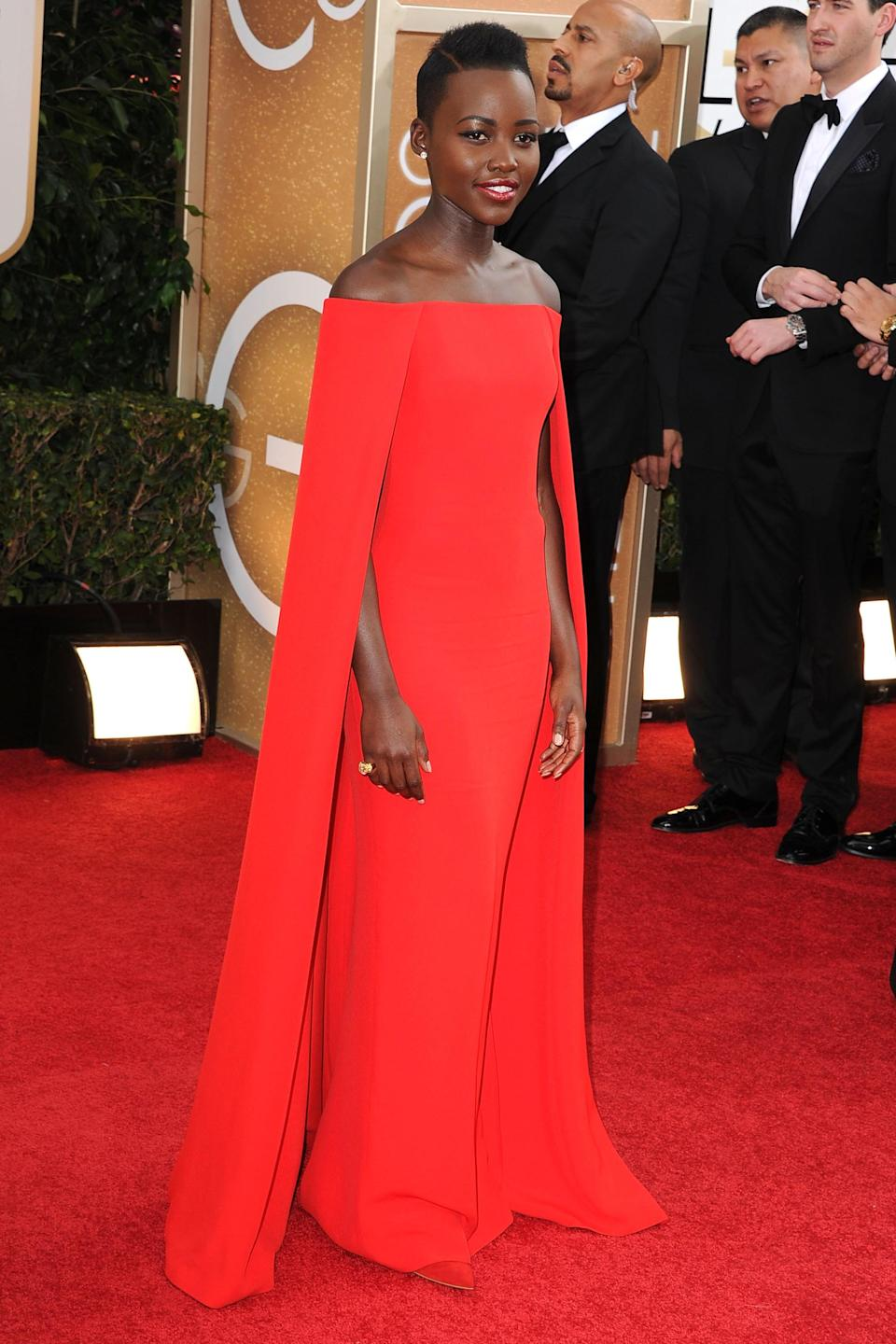 """<strong><h2>2014</h2></strong><br>For a Golden Globes first-timer, Lupita Nyong'o walked this red carpet like a seasoned pro — or rather, a superhero, in this cape-like gown by Ralph Lauren.<br><br><em>Lupita Nyong'o in Ralph Lauren.</em><span class=""""copyright"""">Photo: Steve Granitz/WireImage.</span>"""