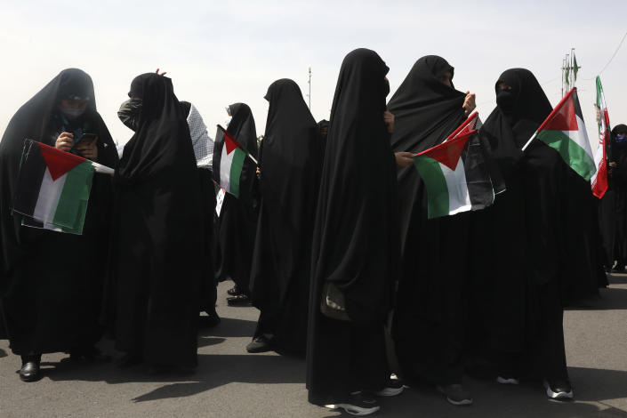 Demonstrators hold Palestinian flags during the annual Al-Quds, or Jerusalem, Day rally in Tehran, Iran, Friday, May 7, 2021. Iran held a limited anti-Israeli rally amid the coronavirus pandemic to mark the Quds Day. After the late Ayatollah Khomeini, leader of the Islamic Revolution and founder of present-day Iran, toppled the pro-Western Shah in 1979, he declared the last Friday of the Muslim holy month of Ramadan as an international day of struggle against Israel and for the liberation of Jerusalem. (AP Photo/Vahid Salemi)