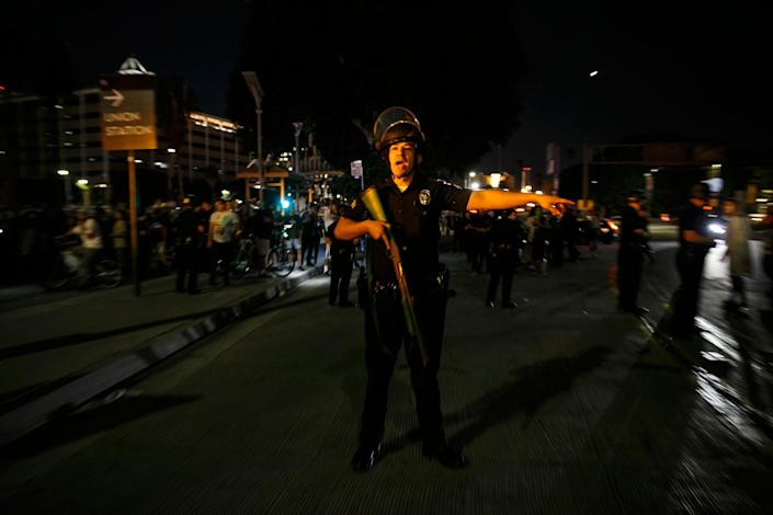 <p>LAPD police officers help direct protester foot traffic in Los Angeles, Calif., on Nov. 10, 2016. (Photo: Marcus Yam/Los Angeles Times via Getty Images) </p>