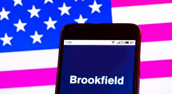 The Brookfield Renewable Partners (BEP) logo is displayed on a smartphone screen in front of a digital American flag background.