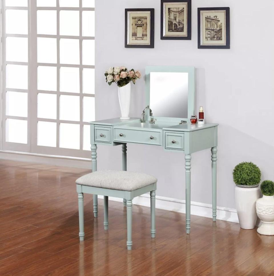 <p>The mirror on this <span>Linon Michelle Vanity Set</span> ($170) folds down so you can also use it like a desk. </p>