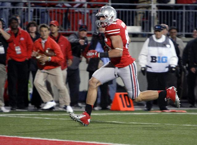 Ohio State tight end Jeff Heuerman scores a touchdown against Nebraska during the second quarter of an NCAA college football game, Saturday, Oct. 6, 2012, in Columbus, Ohio. (AP Photo/Jay LaPrete)