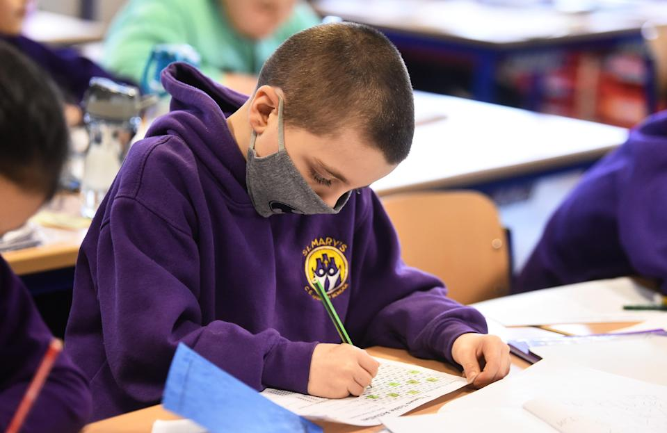 <p>A student attends a lesson at St Mary's CE Primary School on 8 March, 2021 in Stoke on Trent, England. </p> (Getty Images)