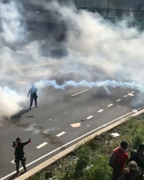 PHOTO: Protesters attempt to climb a hill next to a highway as tear gas is fired by police during a protest against the death of George Floyd, in Philadelphia, June 1, 2020. (Elias Sell via Reuters, FILE)