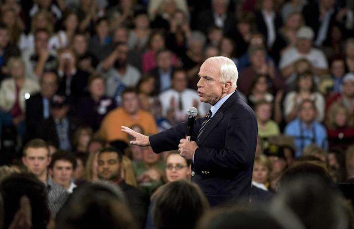 Republican presidential candidate Sen. John McCain addresses a town hall meeting in Lakeville, Minn., in October 2008. He urged his supporters to stop hurling abuse at Barack Obama at his rallies, saying he admired and respected his Democratic rival. (Photo: Jim Watson/AFP/Getty Images)