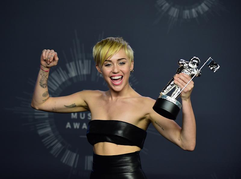 Miley Cyrus poses in the press room during the MTV Video Music Awards (VMA), August 24, 2014 at the Nokia Theatre in downtown Los Angeles