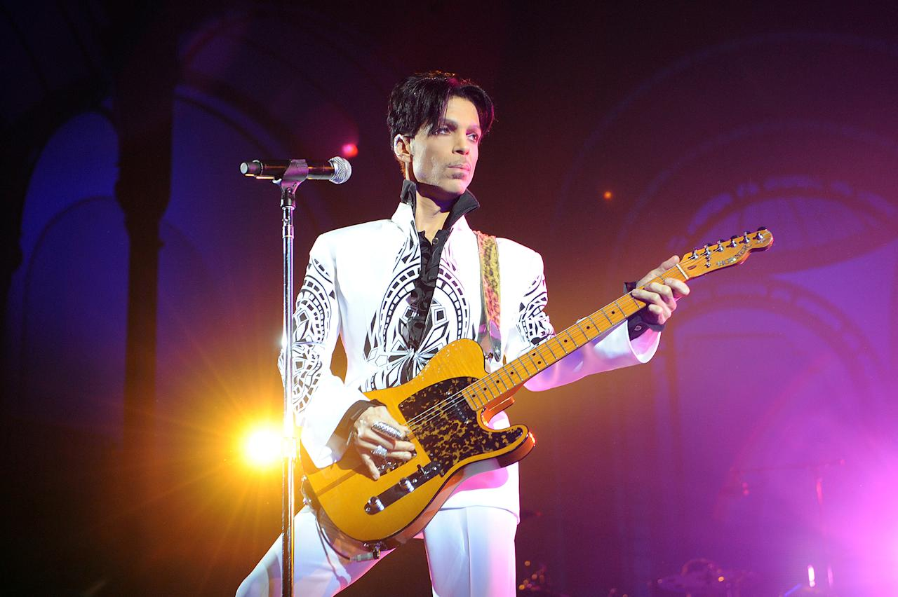 <p>Oldest album to rank No. 1 on the Billboard 200. The Very Best of Prince was nearly 15 years old when it topped the chart in 2016, following Prince's death. Also: Most albums on the Billboard 200 simultaneously (19). And: Most albums in the top 10 simultaneously (five). (Photo: BERTRAND GUAY/AFP/Getty Images) </p>