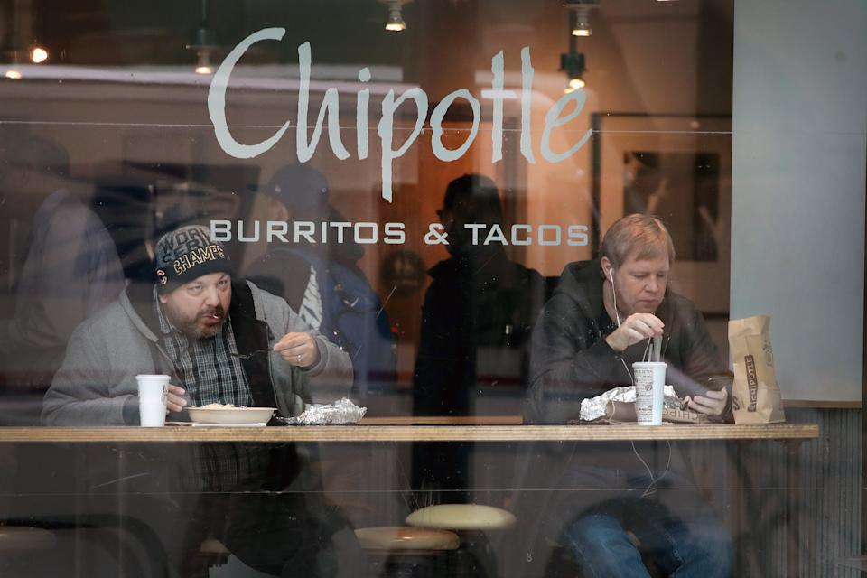 CHICAGO, IL - OCTOBER 25:  Diners eat at a Chipotle restaurant on October 25, 2017 in Chicago, Illinois. Chipotle stock fell more than 14 percent today after a weak 3Q earnings .  (Photo by Scott Olson/Getty Images)