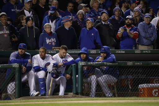 Chicago Cubs players watch from the dugout during the ninth inning of Game 5 (AP)