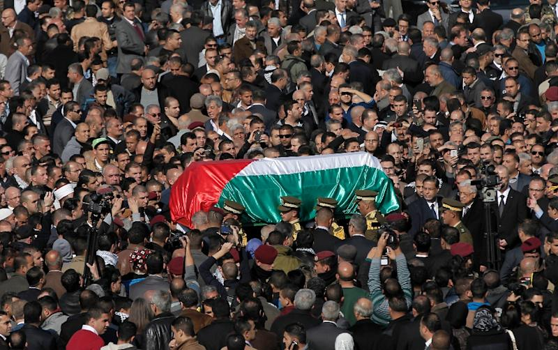 Palestinian security members carry the coffin of senior Palestinian official Ziad Abu Ein during his funeral in the West Bank city of Ramallah on December 11, 2014