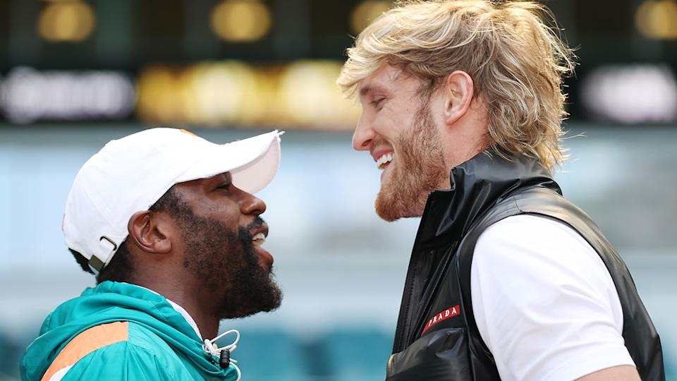 Floyd Mayweather and Logan Paul face off prior to their June 6 match at Hard Rock Stadium in Miami Gardens, Florida. (Photo by Cliff Hawkins/Getty Images)
