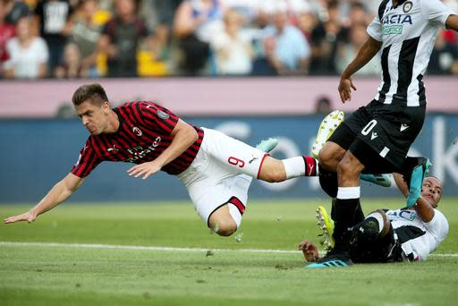 Milan's Krzysztof Piatek falls during the Italian Serie A soccer match between Udinese and AC Milan at the Friuli stadium in Udine, Italy, Sunday, Aug. 25, 2019. (Gabriele Menis/ANSA via AP)
