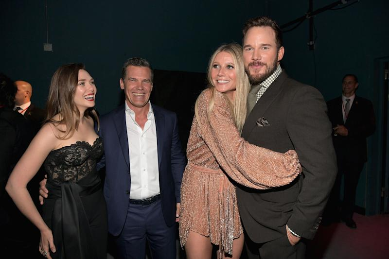 "Gwyneth Paltrow hugs Chris Pratt as Elizabeth Olsen and Josh Brolin look on at the ""Avengers: Infinity War"" premiere in 2018. (Photo: Charley Gallay via Getty Images)"