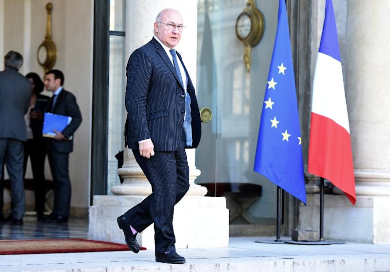 French Finance Minister Michel Sapin leaves the Elysee presidential palace on December 9, 2015 in Paris