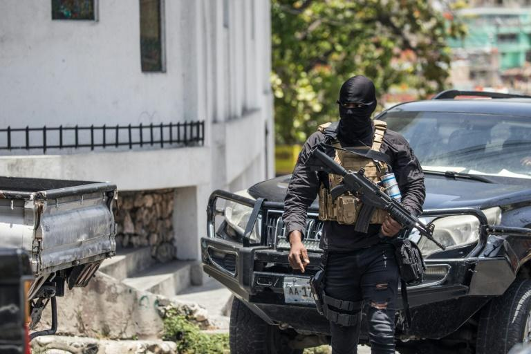 Police patrol the streets in Petionville, Haiti on July 9, 2021 as citizens brace for days of turmoil