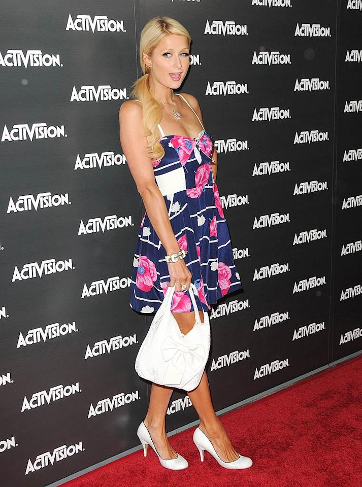 """Paris Hilton rocked the red carpet in a summery frock at the Activision Kickoff Party for the E3 video game conference in Los Angeles Monday night. Who knew the hotel heiress was a gamer? Jordan Strauss/<a href=""""http://www.wireimage.com"""" target=""""new"""">WireImage.com</a> - June 14, 2010"""