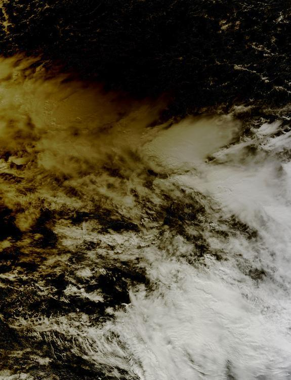 """NASA's Terra satellite captured this shot of the moon's shadow darkening the region northeast of Australia, including the Solomon Islands, during the """"ring of fire"""" solar eclipse on May 9, 2013."""
