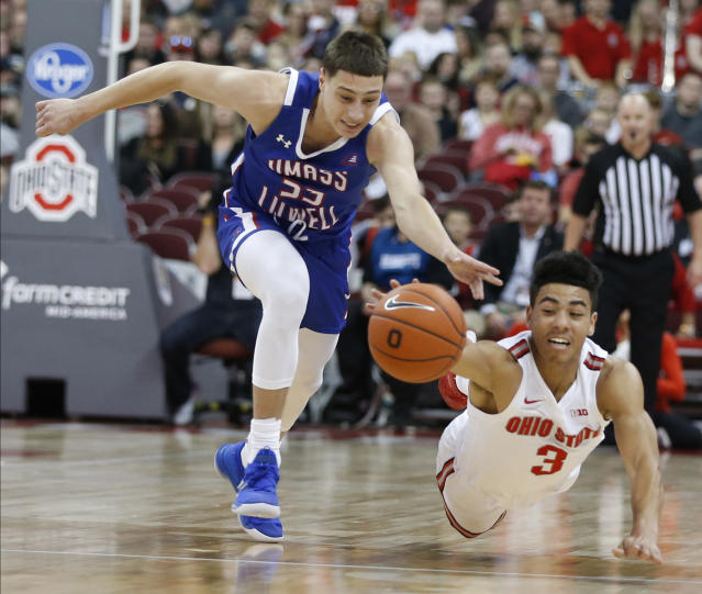 Massachusetts-Lowell's Luka Maziashvili, left, and Ohio State's D.J. Carton reach for the ball during the first half of an NCAA college basketball game Sunday, Nov. 10, 2019, in Columbus, Ohio. (AP Photo/Jay LaPrete)
