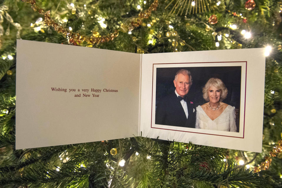LONDON, ENGLAND -DECEMBER 15: Prince Charles, Prince of Wales and Camilla, Duchess of Cornwall's 2017 Christmas card pictured in Clarence House on December 15, 2017 in London, England. The picture on the card was taken by Hugo Burnand showing the royal couple in the Orchard Room during the private 70th birthday party of The Duchess of Cornwall at Highgrove on Saturday 15th July 2017.  (Photo by Victoria Jones - WPA Pool/Getty Images)