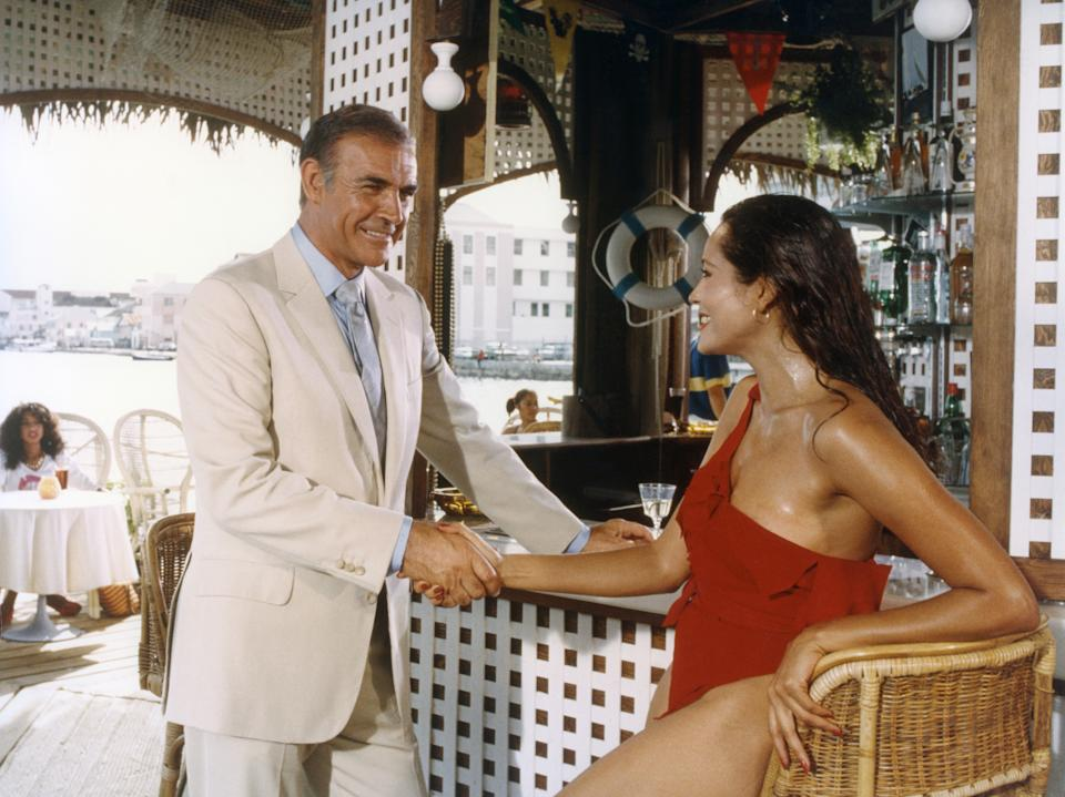Actor Sean Connery and actress Barbara Carrera on the set of