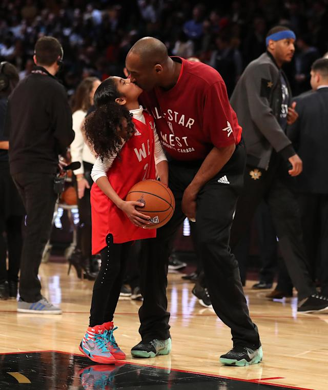 Kobe Bryant gets a kiss from his daughter Gianna Bryant during the 65th NBA All-Star Game at the Air Canada Centre in Toronto. February 14, 2016. (Steve Russell/Toronto Star via Getty Images)