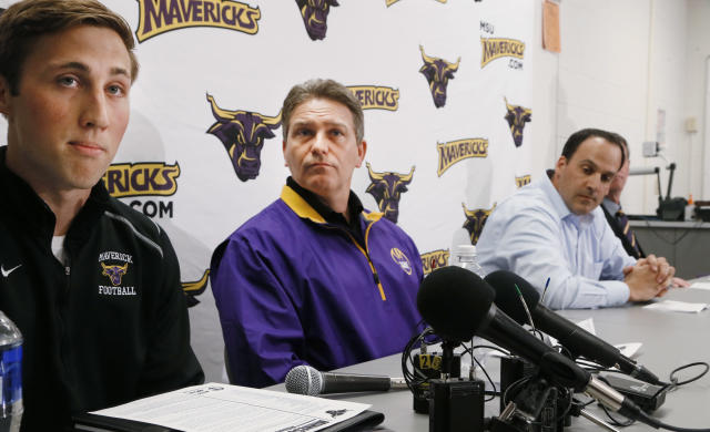 Minnesota State, Mankato defensive back Sam Thompson, left, reads a statement during a news conference as, from second from left, coach Todd Hoffener, associate coach Aaron Keen and athletic director Kevin Buisman listen Thursday, April 17, 2014, in Mankato, Minn. (AP Photo/Star Tribune, Jerry Holt)