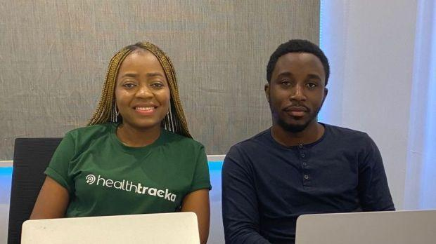 A picture of Healthtracka founder Ifeoluwa Dare-Johnson, in a green shirt, with one of her staff.