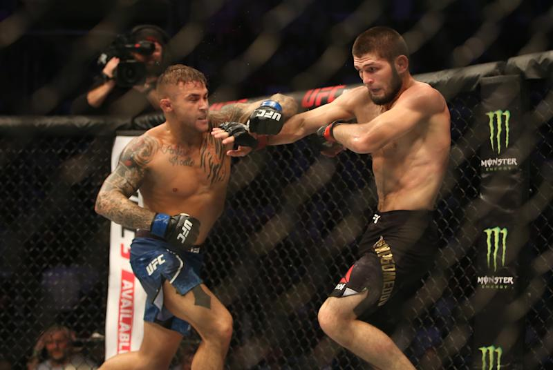 ABU DHABI, UNITED ARAB EMIRATES - SEPTEMBER 06: Khabib Nurmagomedov (red) in action against Dustin Poirier (blue) during UFC Lightweight Championship match at Yas Island in Abu Dhabi, United Arab Emirates on September 6, 2019. (Photo by Stringer/Anadolu Agency via Getty Images)