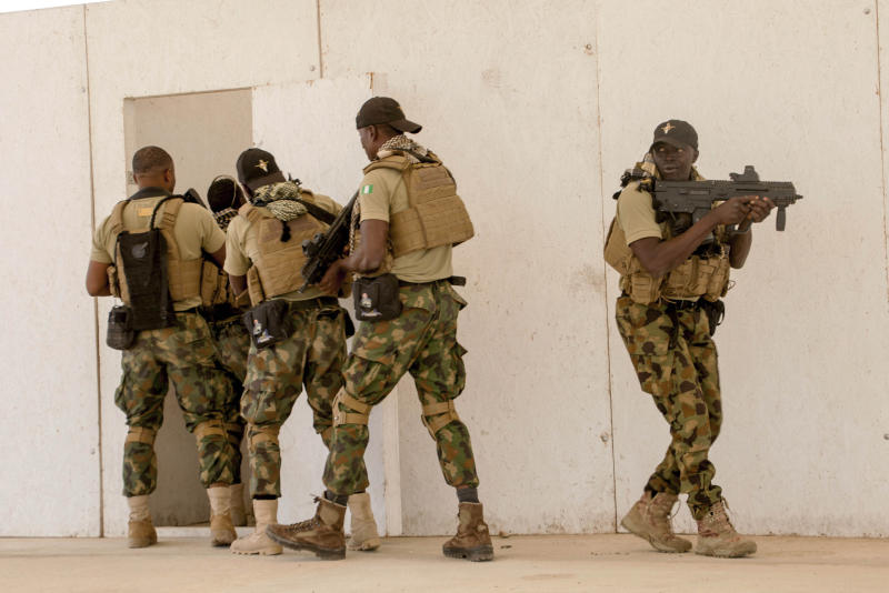 In this Tuesday Feb. 18, 2020, photo, Nigerian Navy Special Boat Service troops exercise under the supervision of British special forces during U.S. military-led annual counterterrorism exercise in Thies, Senegal. More than 1,500 service members from the armies of 34 African and partner training nations have assembled for the Flintlock exercises in Senegal and Mauritania, the two countries in West Africa's sprawling Sahel region that so far have not been hit by violence from extremists linked to al-Qaida or the Islamic State group. (AP Photo/Cheikh A.T Sy)