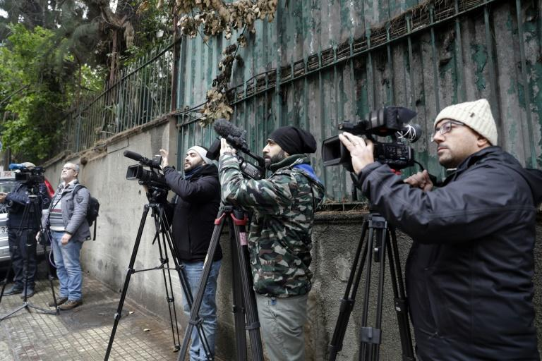 Members of the Lebanese media wait in front of a house identified by court documents as belonging to former Nissan chief Carlos Ghosn in a wealthy Beirut neighbourhood (AFP Photo/ANWAR AMRO)