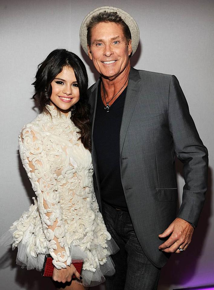 "Think Selena Gomez was jealous that her boyfriend Justin was posing with Hayden? Nah, as the host of the MTV EMAs -- who had nine wardrobe changes! -- Selena got her own photo op with The Hoff. Plus, JBiebs later tweeted: ""Great job tonight @selenagomez at the EMA's. proud of u."" (11/6/2011)"