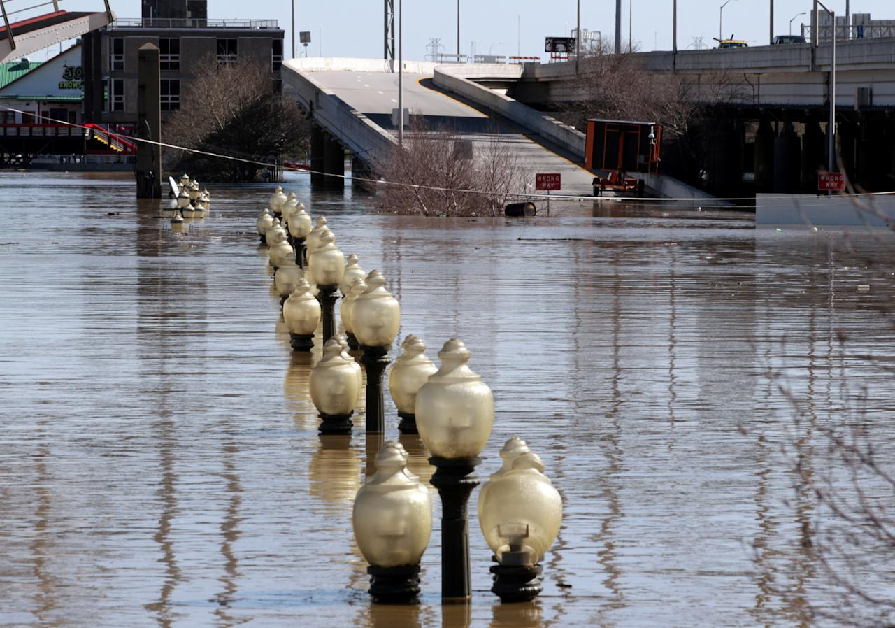 <p>Water covers downtown streets after the Ohio River flooded in Louisville, Ky., Feb. 26, 2018. (Photo: John Sommers II/Reuters) </p>