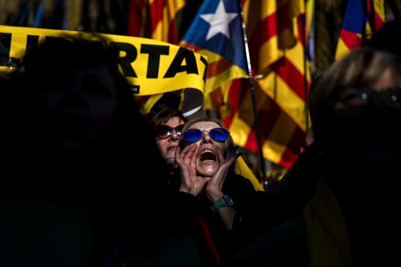 <p> People gather outside the Catalonia parliament during a parliamentary session in Barcelona, Spain, Wednesday, Jan. 17, 2018. A new Catalan parliament is meeting following a botched secession attempt last year and amid looming questions about the role that fugitive and jailed politicians will play in the chamber's separatist majority. (AP Photo/Emilio Morenatti) </p>