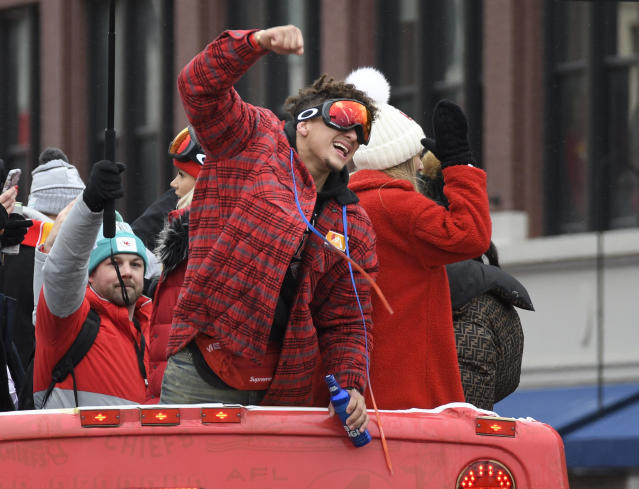 Kansas City Chiefs quarterback Patrick Mahomes cheers with the crowd during a parade through downtown Kansas City after Super Bowl LIV. (AP Photo/Reed Hoffmann)