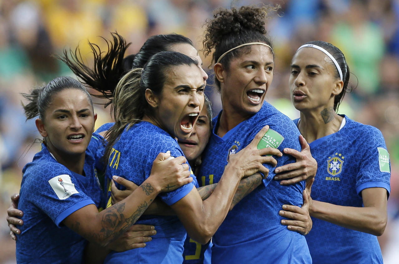 Brazil's Marta, second left, celebrates with teammates after scoring the opening goal during the Women's World Cup Group C soccer match between Australia and Brazil at Stade de la Mosson in Montpellier, France, Thursday, June 13, 2019. (AP Photo/Claude Paris)