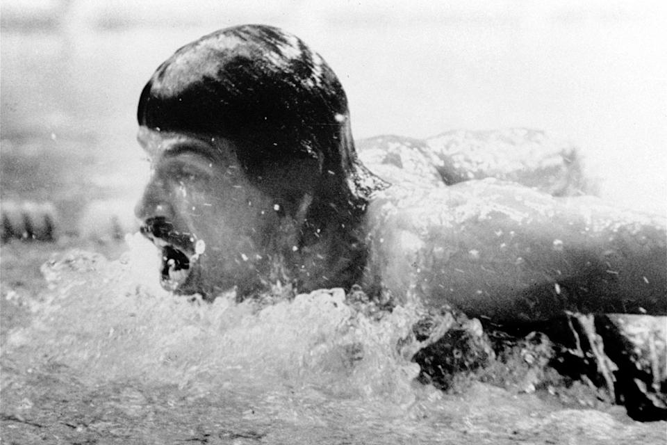 FILE - In this Sept. 4, 1972, file photo, American swimmer, Mark Spitz, competes in the butterfly segment of the 400-meter medley swimming event at the Summer Olympic swim hall in Munich, Germany. The American team placed first setting up a new world record in 3:48.16 min. (AP Photo/File)