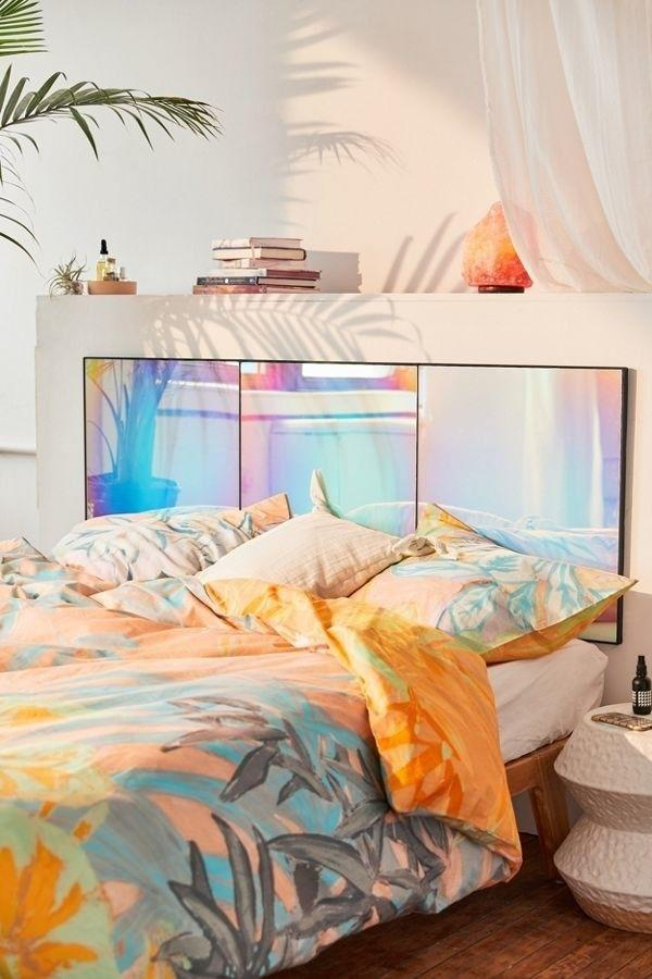 """This beautiful headboard will look positively dreamy in your bedroom. But if you don't want it over your bed, it can also be used as a full-length or vanity mirror.<br /><br /><strong>Promising review:</strong>""""This headboard is so unique!<strong>I wasn't sure how vivid the colors would be in person, but when it showed up I was blown away.</strong>The quality is pretty great!"""" —Joshuasmiller614<br /><br /><strong>Get it on sale from Urban Outfitters for<a href=""""https://go.skimresources.com?id=38395X987171&xs=1&xcust=HPHomeMagazine-609acebfe4b099ba752f64c2-&url=https%3A%2F%2Fwww.urbanoutfitters.com%2Fshop%2Frainbow-iridescent-headboard"""" target=""""_blank"""" rel=""""nofollow noopener noreferrer"""" data-skimlinks-tracking=""""5854435"""" data-vars-affiliate=""""Rakuten"""" data-vars-campaign=""""SHOPMagazineHomeMower2-2-2021--5854435-"""" data-vars-href=""""https://click.linksynergy.com/deeplink?id=yPKHhJU2qBg&mid=43176&murl=https%3A%2F%2Fwww.urbanoutfitters.com%2Fshop%2Frainbow-iridescent-headboard%3Fcolor%3D095%26type%3DREGULAR%26size%3DONE%2520SIZE%26quantity%3D1&u1=SHOPMagazineHomeMower2-2-2021--5854435-"""" data-vars-keywords=""""fast fashion"""" data-vars-link-id=""""16331380"""" data-vars-price="""""""" data-vars-product-id=""""20945823"""" data-vars-product-img=""""https://s7d5.scene7.com/is/image/UrbanOutfitters/45224060_095_b?$xlarge$&fit=constrain&qlt=80&wid=100"""" data-vars-product-title=""""Rainbow Iridescent Headboard"""" data-vars-redirecturl=""""https://www.urbanoutfitters.com/shop/rainbow-iridescent-headboard?color=095&type=REGULAR&size=ONE%20SIZE&quantity=1"""" data-vars-retailers=""""Urban Outfitters,urbanoutfitters"""" data-ml-dynamic=""""true"""" data-ml-dynamic-type=""""sl"""" data-orig-url=""""https://click.linksynergy.com/deeplink?id=yPKHhJU2qBg&mid=43176&murl=https%3A%2F%2Fwww.urbanoutfitters.com%2Fshop%2Frainbow-iridescent-headboard%3Fcolor%3D095%26type%3DREGULAR%26size%3DONE%2520SIZE%26quantity%3D1&u1=SHOPMagazineHomeMower2-2-2021--5854435-"""" data-ml-id=""""20"""">$399</a>.</strong>"""