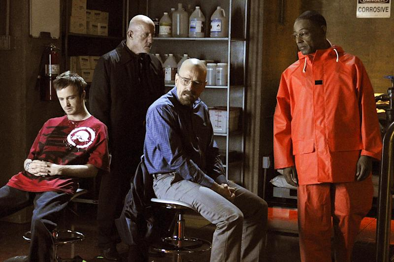 "This image released by AMC shows, from left, Jesse Pinkman, played by Aaron Paul, Mike Ehrmantraut, played by Jonathan Banks, Walter White, played by Bryan Cranston and Gustavo ""Gus"" Fring, played by Giancarlo Esposito in a scene from season four of ""Breaking Bad."" Any ""Breaking Bad "" fan could be forgiven for concluding that Sunday's finale held no major surprises. That's because this AMC drama series has delivered surprises, shock and OMG moments dependably since its premier five seasons ago. Just like it did on its final episode. (AP Photo/AMC, Ursula Coyote)"