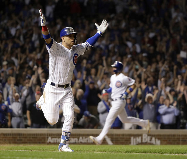 Chicago Cubs' Albert Almora Jr., left, celebrates his game winning RBI single off Los Angeles Dodgers relief pitcher Brock Stewart, as Kris Bryant, right, scores the winning run during the 10th inning of a baseball game Tuesday, June 19, 2018, in Chicago. The Cubs won 2-1. (AP Photo/Charles Rex Arbogast)