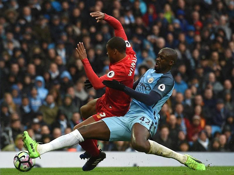 Toure was lucky not to concede a penalty in the first-half (Getty)
