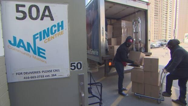 On Friday, boxes of food were delivered to families facing food insecurity in the Jane and Finch area as part of an initiative involving non-profit organizations like Remember the 400 and African Food Basket.   (Martin Trainor/CBC - image credit)
