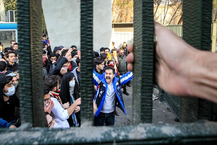 <p>People gather to protest over high cost of living in Tehran, Iran on December 30, 2017. (Photo: Stringer/Anadolu Agency/Getty Images) </p>