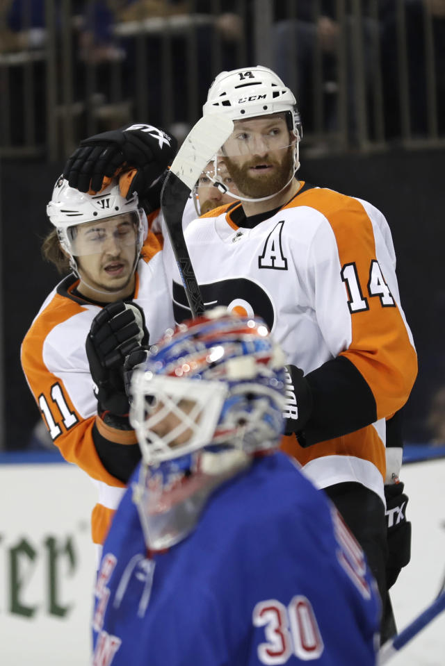 Philadelphia Flyers' Sean Couturier, right, celebrates his goal with Travis Konecny as New York Rangers goaltender Henrik Lundqvist reacts during the first period of the NHL hockey game, Sunday, March 1, 2020, in New York. (AP Photo/Seth Wenig)