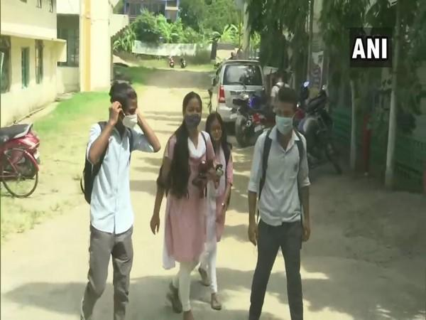 Students of the SB Deora college attending classes after several months. (Photo/ANI)