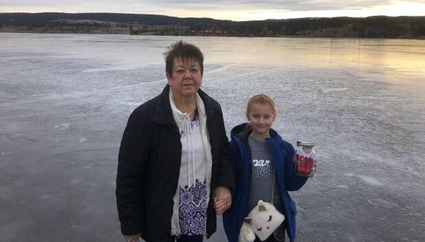 Rick McGowan's wife, Patti McGowan, and his granddaughter stand beside a frozen-over Stoney Lake in December 2018, a week after public access was granted by the B.C. Supreme Court —a ruling that has now been overturned by the B.C. Court of Appeal .