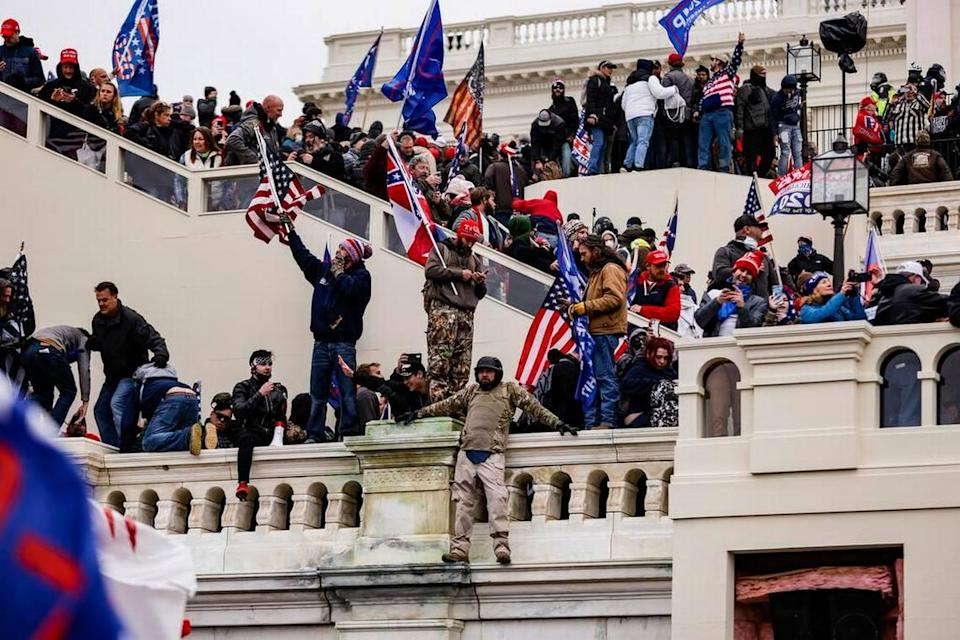 Pro-Trump supporters storm the U.S. Capitol following a rally with President Donald Trump on Wednesday, Jan. 6, 2021 in Washington, D.C. (Samuel Corum/Getty Images/TNS)