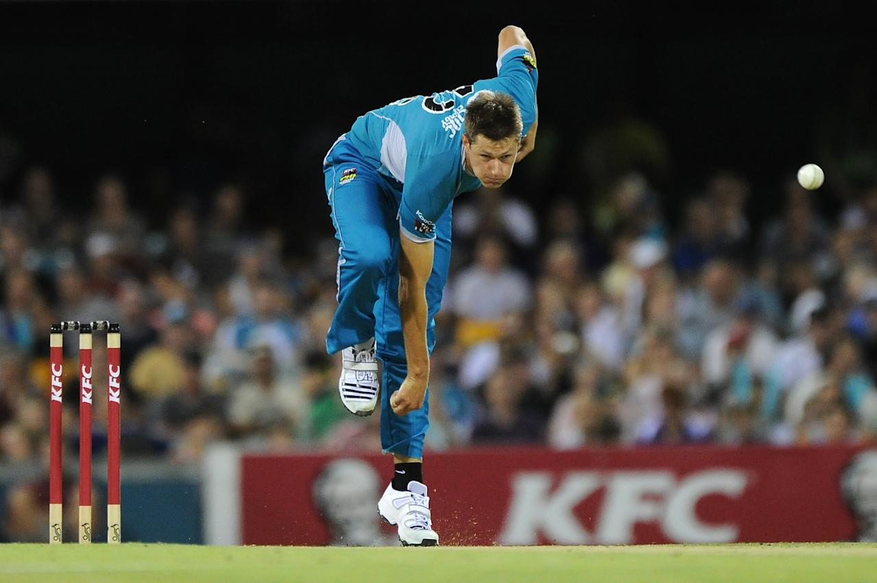 BRISBANE, AUSTRALIA - DECEMBER 09:  Cameron Gannon of the Heat bowls during the Big Bash League match between the Brisbane Heat and the Hobart Hurricanes at The Gabba on December 9, 2012 in Brisbane, Australia.  (Photo by Matt Roberts/Getty Images)