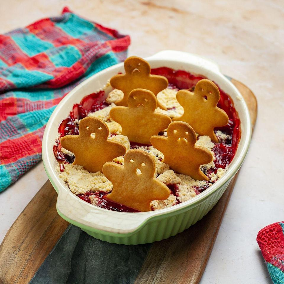 """<p>This boozy and warming crumble will put a smile on your guest's faces. The gingerbread mixture makes more biscuits than you need, but they keep well and are delicious with a cup of tea or hot milk.</p><p><strong>Recipe: <a href=""""https://www.goodhousekeeping.com/uk/christmas/christmas-recipes/a34758582/gingerbread-gin-apple-blackberry-crumble/"""" rel=""""nofollow noopener"""" target=""""_blank"""" data-ylk=""""slk:Gingerbread Gin Apple and Blackberry Crumble"""" class=""""link rapid-noclick-resp"""">Gingerbread Gin Apple and Blackberry Crumble</a></strong></p>"""