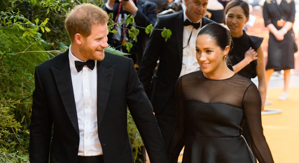 Meghan Markle and Prince Harry have reportedly been breaking etiquette by insisting on sitting next to each other at dinner parties [Image: Getty]